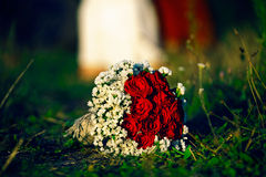 Bridal wedding bouquet of flowers. Wedding bouquet in the summer landscape Stock Image