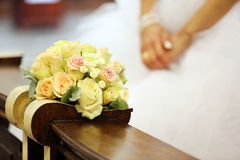 Bridal wedding bouquet lying on the hassock during the marriage Royalty Free Stock Photography