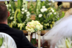 Bridal wedding bouquet lying on the hassock Stock Image