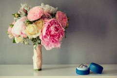 Bridal Wedding Bouquet with rings on a white table Royalty Free Stock Images