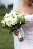 Bridal wedding flowers. Brides bouquet of wedding flowers, held in her hand Royalty Free Stock Photos