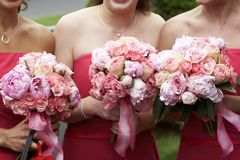 Bridal wedding flowers and bouquets. Three brides maid bouquets in shades of red and pink Stock Photography