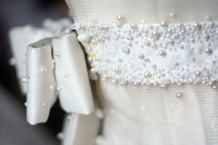 Bridal Wedding Gown. A close up image of a white wedding gown Stock Image