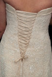 Bridal Wedding Gown Laced Up. Wedding gown laced up in the back Stock Photography