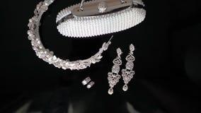 Bridal wedding jewelry. On black background isolated stock footage