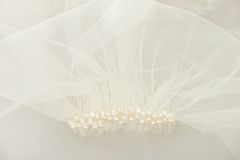 Bridal wedding veil with a pearl comb. Ivory bridal wedding veil with a pearl comb under the veil Royalty Free Stock Photography