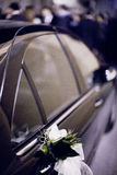 Bridal white flower bouquet on wedding car door Royalty Free Stock Photography