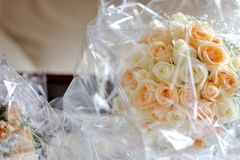 Bridal white and pink roses bouquet still wrapped in plastic Royalty Free Stock Image