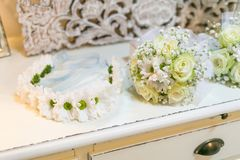 Bridal wreath with flowers and wedding bouquets. Bridal wreath with flowers and bouquets, beautiful wedding accessory for  bridesmaids Stock Image