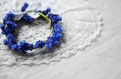 Bridal wreath lying on a lace napkin. Wedding accessories. Blue flowers. Royalty Free Stock Photo