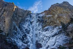 Bridalveil waterfall at Yosemite Park. Bridalveil waterfall from bellow; the water around the waterfall froze and frames the main fall in ice, the rest of the Stock Photo