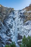 Bridalveil waterfall at Yosemite Park. Bridalveil waterfall from bellow; the water around the waterfall froze and frames the main fall in ice, the rest of the Stock Photography