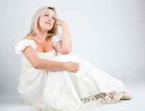 Bride. Young bride in white dress on gray background Royalty Free Stock Image