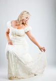 Bride. Young bride in white dress on gray background Stock Photos