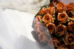 Bride. A bouquet of orange roses Stock Image