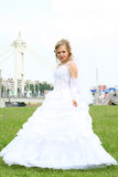 Bride. Young beautiful bride in white dress outdoors Royalty Free Stock Photo