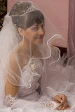 Bride. Are smiling under wedding veil Royalty Free Stock Photo