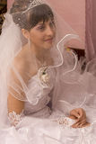 Bride. Are smiling under wedding veil Royalty Free Stock Image