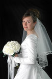 Bride. On Wedding Day with Bouquet of Flowers Stock Images