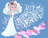 Bride. The bride is the path strewn with rose petals in the form of hearts Stock Image