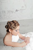 Bride. Stylish bride is sitting and looking down Stock Photo