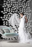Bride. Dancing bride near the chair with pillows Royalty Free Stock Photos