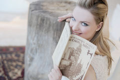 Bride. Lady holding a book and smiling Royalty Free Stock Photography