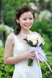 Bride. In Wedding Dress with flowers outdoor shot stock photo