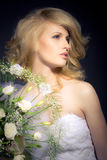 The Bride. Posing with white bridal bouquet Stock Photos
