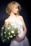 The Bride. Posing with white bridal bouquet Royalty Free Stock Image