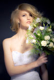 The Bride. Posing with white bridal bouquet Royalty Free Stock Photos