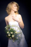 The Bride. Posing with white bridal bouquet Stock Photo