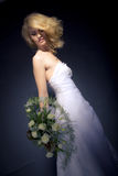 The Bride. Posing with white bridal bouquet Stock Photography