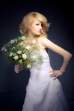 The Bride. Posing with white bridal bouquet Royalty Free Stock Photo