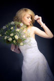 The Bride. Posing with white bridal bouquet Stock Images