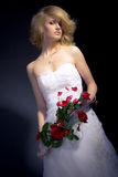 The Bride. Posing with red bridal bouquet Royalty Free Stock Photography