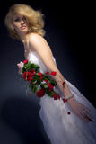 The Bride. Posing with red bridal bouquet Stock Photography