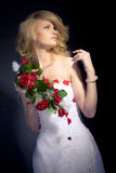 The Bride. Posing with red bridal bouquet Stock Image