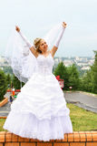 Bride. Happy bride in white dress with hands up Royalty Free Stock Images