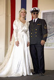 Bride in 1940s wedding dress posing with her father dressed as a Navy Officer Royalty Free Stock Photography