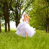 The bride. Runs on park Royalty Free Stock Images