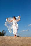 Bride. The girl in a white dress against the dark blue sky Stock Photos