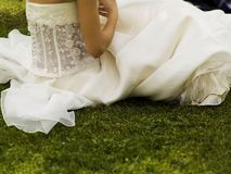 Bride. Resting on the grass after ceremony stock photo