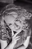 Bride. Beautiful young smiling bride with modern wedding hairstyle - long curly hairs Stock Photography
