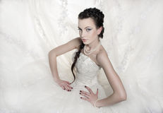 Bride. The beautiful bride poses in a white wedding dress Stock Photo