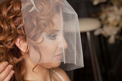 Bride. Happy bride in the coiffeur. In white dress. Isolated over black background stock photos