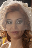 Bride. Happy bride in the coiffeur. In white dress. Isolated over black background royalty free stock images