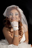 Bride. Happy bride in the studio. In white dress. Isolated over black background stock photos