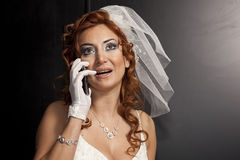 Bride. Happy bride in the studio. In white dress. Isolated over black background stock photo