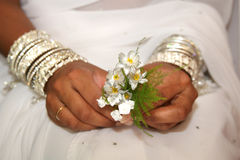 Bride. Indian Bride holding flowers with white saree Royalty Free Stock Photo